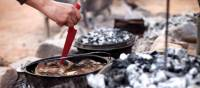 Cooking on hot coals at Camp Fearless   Guy Wilkinson