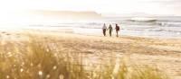 A couple walking on the beach on Bruny Island