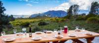 Delicious meals and wine are served each evening on the Cradle Huts walk | Great Walks of Australia