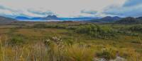 Walking towards Lake Pedder with Mount Solitary in the background  | Tourism Australia & Graham Freeman