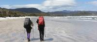 A couple treks the remote beaches along the South Coast Track | Phil Wyndham